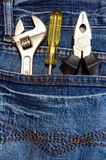 Tools and jeans Royalty Free Stock Images