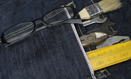 Tools and jeans pocket Stock Images