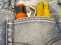Tools and jeans pocket Royalty Free Stock Photo