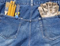 Tools and jeans pocket Stock Photography