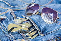 Tools in Jeans pocket with sunglasses background concept Royalty Free Stock Photos