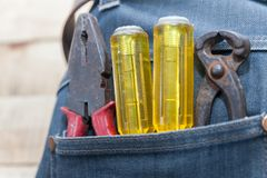 Tools in jeans pocket Royalty Free Stock Image
