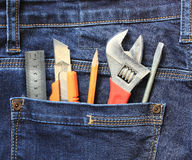Tools in jeans pocket Royalty Free Stock Photo