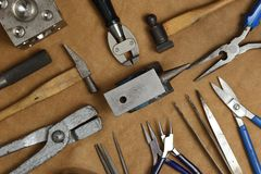 Tools of jewellery. Jewelry workplace on leather background with copy space for text. Top view.  royalty free stock photo