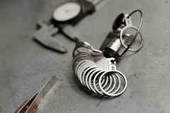 Tools of jewellery. Jewelry workplace on metal background. Finger sizing for rings, beam compass, pincer Royalty Free Stock Images