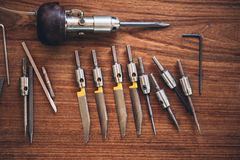 Tools for jewelry engraving. Closeup of a collection of hand engraving tools sitting on a table in a jewelery workshop stock photography