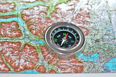 Tools for the journey - map and compass. Royalty Free Stock Image