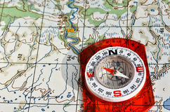 Tools for the journey - map and compass. Stock Photography