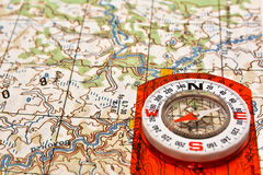 Tools for the journey - map and compass. Stock Photo