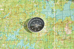Tools for the journey - map and compass. Royalty Free Stock Photography