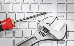 Tools on keyboard of computer Royalty Free Stock Photos