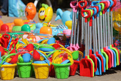 Tools for kids in outdoor shop. Essential beach plastic tools for kids in outdoor shop royalty free stock photo