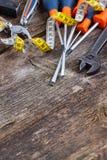 Tools kit frame on wooden planks Stock Image