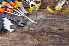 Tools kit frame on wooden planks Royalty Free Stock Photography
