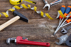 Tools kit frame on wooden planks Royalty Free Stock Image