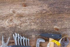 Tools kit frame on wooden planks Royalty Free Stock Images