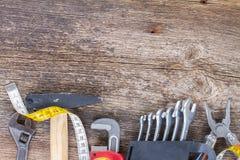 Tools kit frame on wooden planks Stock Photos