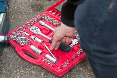Tools kit. Mechanic using a briefcase with socket wrenches Stock Photography