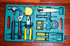 Tools kit. A variety of tools in box on the wooden floor Royalty Free Stock Image