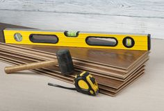 Carpentry concept. Different tools on the new laminate flooring.Copy space for text. Tools for laying laminate flooring. Copy space for text. Carpentry concept Stock Image