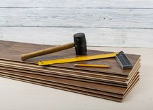 Carpentry concept.Different tools on the new laminate flooring.Copy space for text. Tools for laying laminate flooring. Copy space for text. Carpentry concept Stock Photos