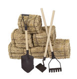 Tools Leaning on a Stack of Hay Royalty Free Stock Photos