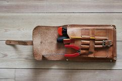 Tools. Leather bag. Leather tool bag with handtools. wooden plank background Royalty Free Stock Images