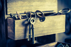 Tools, locks and keys in old locksmiths workshop Royalty Free Stock Photography
