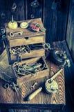Tools, locks and keys in vintage locksmiths workshop Stock Images