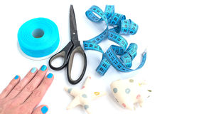 Tools and materials for creativity and Hobbies. The scissors in the girls hand. White background. Tape, tapes, star, and fish tissue Royalty Free Stock Image