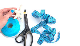 Tools and materials for creativity and Hobbies. The scissors in the girls hand. White background. Tape, tapes, star, and fish tissue Stock Photos