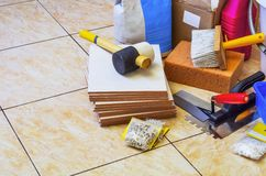 Tools and materials for laying of tile. Preparations for laying tile, topic Construction and repair Stock Images