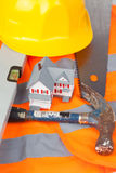 Tools and miniature house Stock Photos