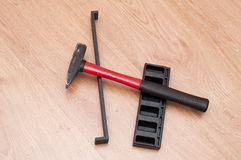 Tools for mounting laminated floor. Tools for mounting laminated parquet laying on the floor royalty free stock photography