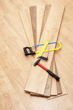 Tools for mounting laminated floor Stock Photos