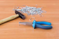 Tools and nails on wooden background royalty free stock photo