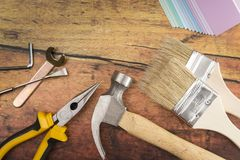 Tools and Needed Things for Home Improvement. On a Wooden Table stock photo