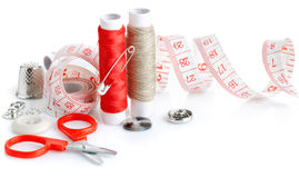 Tools for needlework thread scissors. And tape measure on white background Stock Image