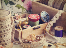 Tools for needlework, thread for sewing, scissors, buttons and laces Stock Photo