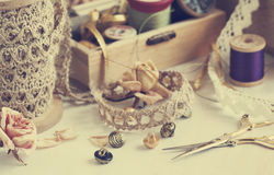 Tools for needlework, thread for sewing, scissors, buttons and v Royalty Free Stock Image
