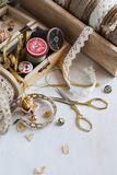 Tools for needlework, thread for sewing, scissors and buttons and vintage laces Stock Photo