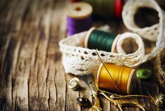 Tools for needlework, thread for sewing, scissors and buttons Royalty Free Stock Photo