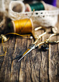 Tools for needlework, thread for sewing, scissors and buttons royalty free stock images