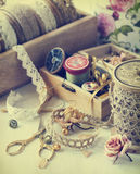 Tools for needlework, thread for sewing, scissors, buttons and vintage laces. Toned image stock photos