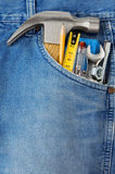 Tools in old blue jeans Stock Photography