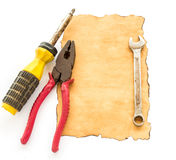Tools and old paper on white background Stock Images