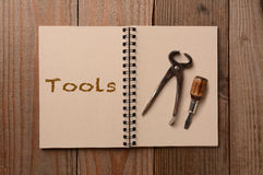 Tools on an Open Notebook Stock Photo