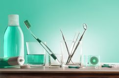 Tools for oral hygiene on wooden table with green background. Horizontal composition. Front view royalty free stock images
