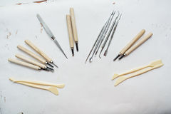Tools painter. Professional tools and stacks, incisors of paint on paper background Stock Photo