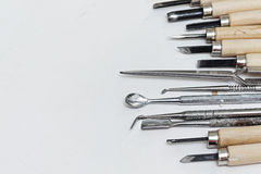 Tools painter. Professional tools and stacks, incisors of paint on paper background Stock Images